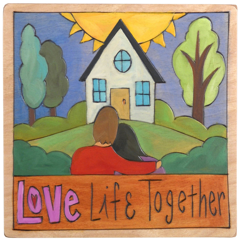 "Sticks handmade wall plaque with ""Love Life Together"" quote and couple in front of their home imagery"