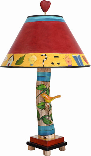 Log Table Lamp –  Colorful and vibrant table lamp with vine motifs and bird element