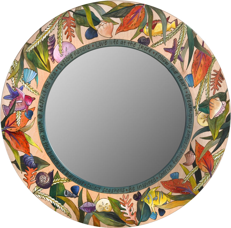 Large Circle Mirror –  Eclectic folk art mirror with all variety of shells and sea flora