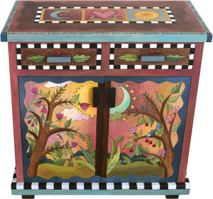 "Small Buffet –  ""Live by the Sun/Love by the Moon"" small buffet with sun and moon in a pink sky over a green horizon motif"