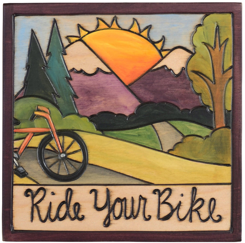 "Sticks handmade wall plaque with ""Ride your bike"" quote and mountain landscape"