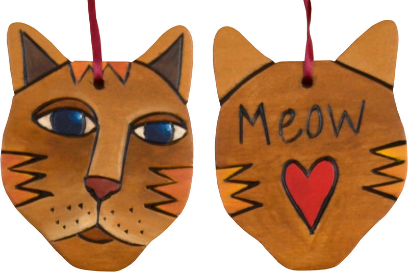 "Tan-orange cat with ""meow"" and heart motif on back"