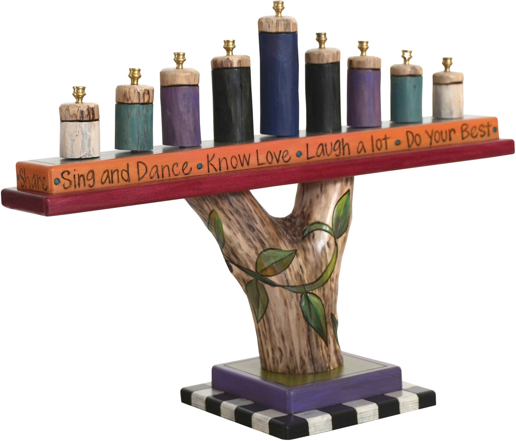 Log Menorah –  Lovely menorah design with natural birch elements and vine motifs
