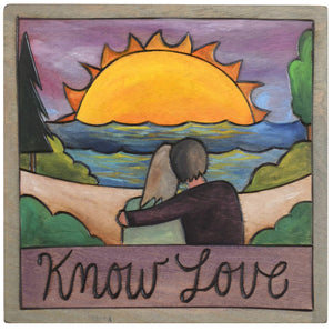 "Sticks handmade wall plaque with ""Know love"" quote and couple at the beach at sunrise or sunset scene"