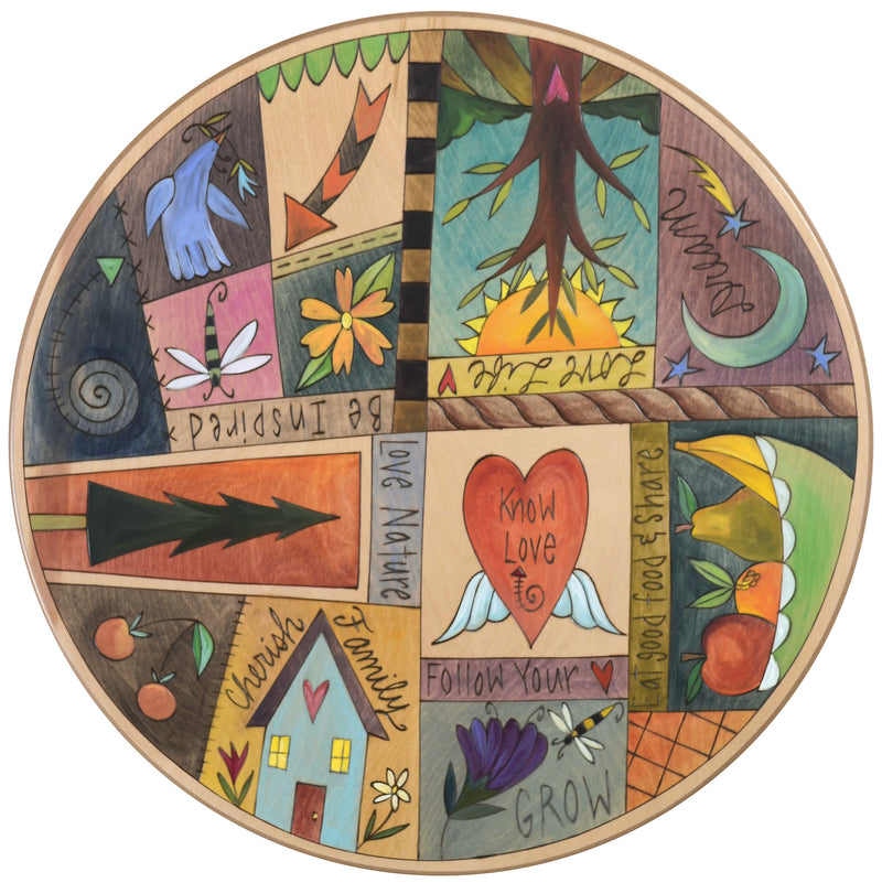 "Sticks Handmade 20""D lazy susan with playful and colorful life icons and symbols"