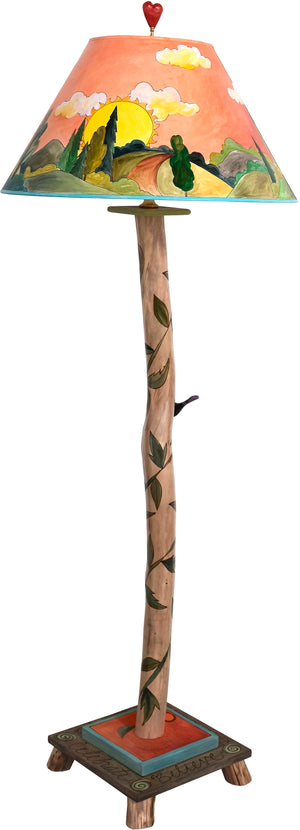 Log Floor Lamp –  Sun and moon themed landscape lamp with vine motifs