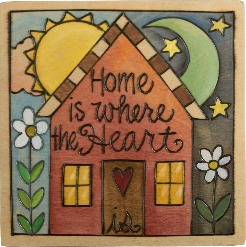 "Sticks handmade wall plaque with ""Home is where the heart is"" quote and cheery home imagery"