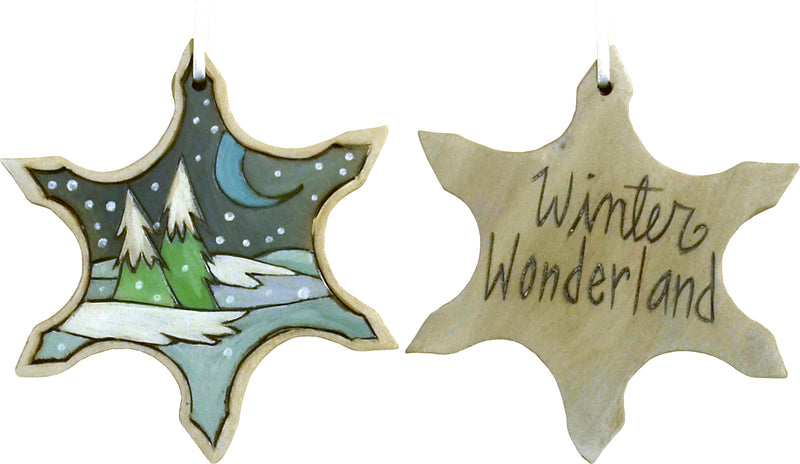"Snowflake Ornament –  ""Winter Wonderland"" snowflake ornament with moon over snow-covered pine trees motif"