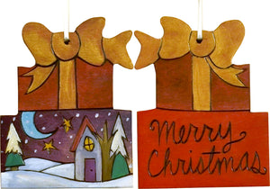 "Present Ornament –  ""Merry Christmas"" present ornament with yellow ribbon and snowy home motif"