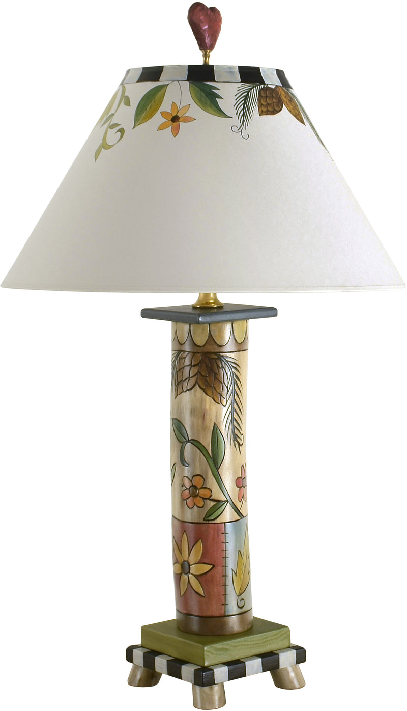 Log Table Lamp –  Elegant table lamp with flora and vine motifs