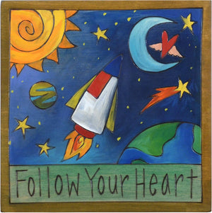 "Sticks handmade wall plaque with ""Follow your heart"" quote and rocket into space imagery"