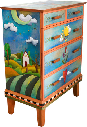 Tall Dresser –  This predominately blue dresser features a tree of life in the landscape design