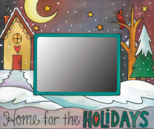 """Home for the holidays"" frame with winter landscape and heart home in the quiet of night"