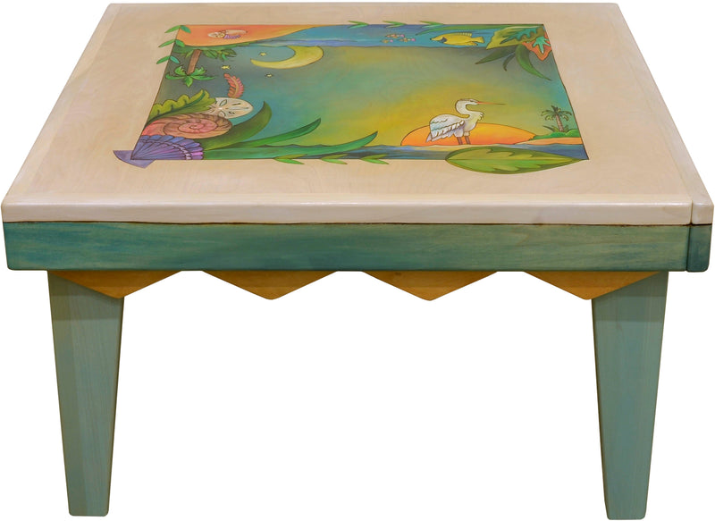 Square Coffee Table –  Whitewash and cool Caribbean colors give this tropical coffee table a funky vibe