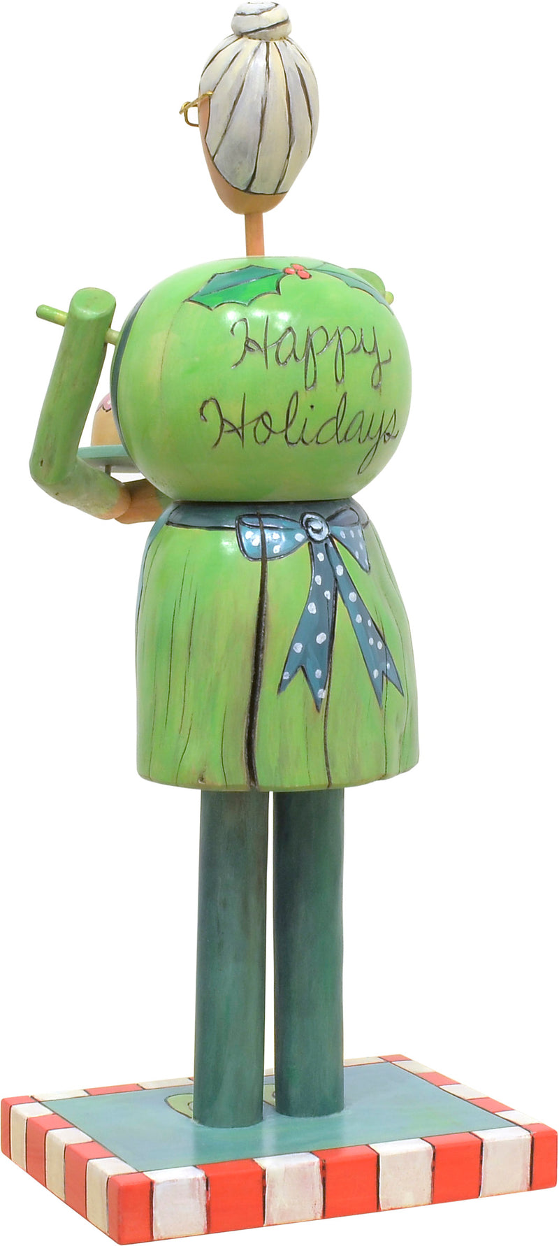 Mrs. Claus Sculpture –  Green and blue Mrs. Claus with a crazy quilt icon apron and a cake