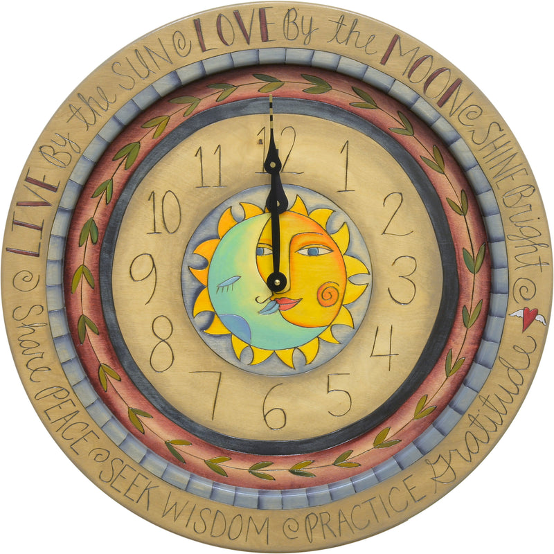 "Celestial wall clock with a ""live by the sun, love by the moon"" theme, done in a classic color palette"