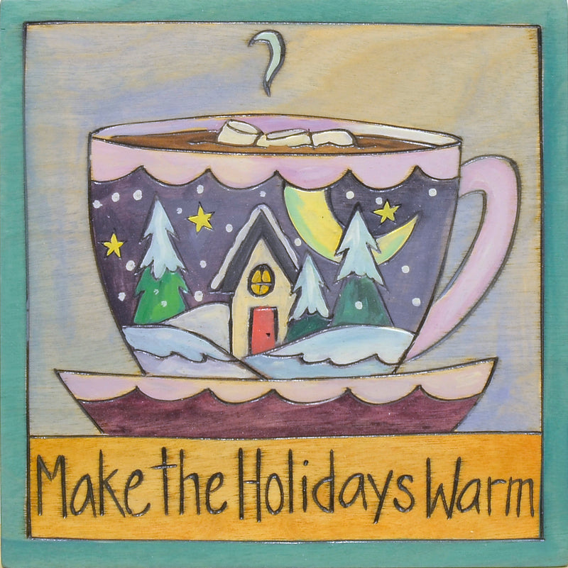"""Make the holidays warm"" with a hot chocolate mug with a landscape motif"