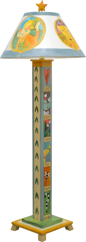 Seasonal critter medallions fill this lamp shade and the base features folky stacked boxed icons