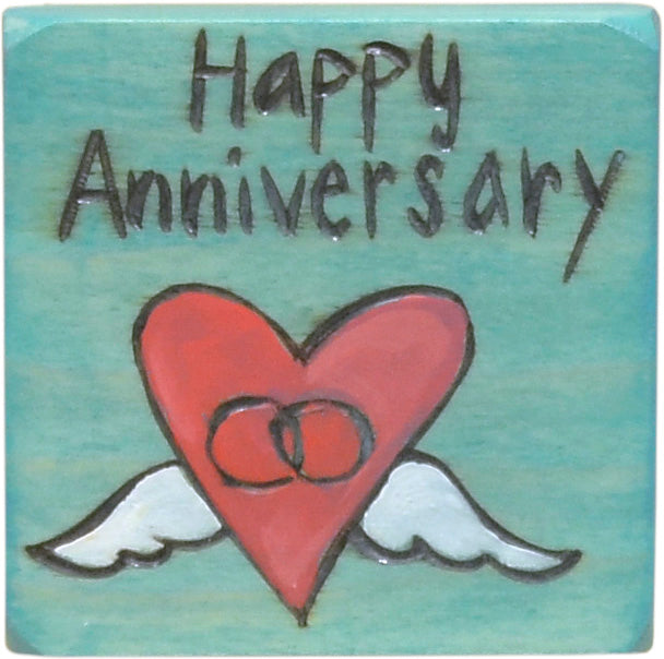 """Happy Anniversary"" magnet with rings in a heart with wings motif"