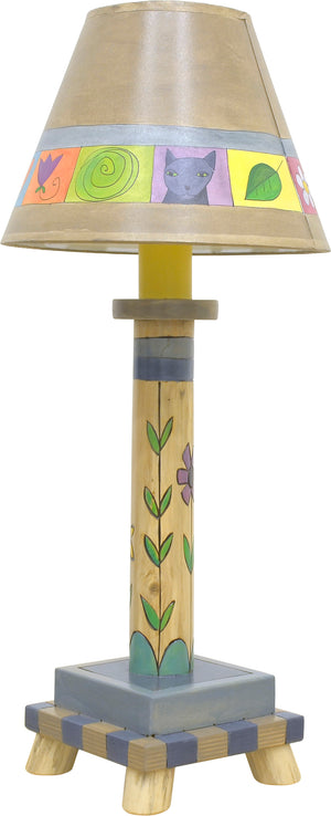Log Candlestick Lamp –  Warm boxed icon and floral log lamp motif