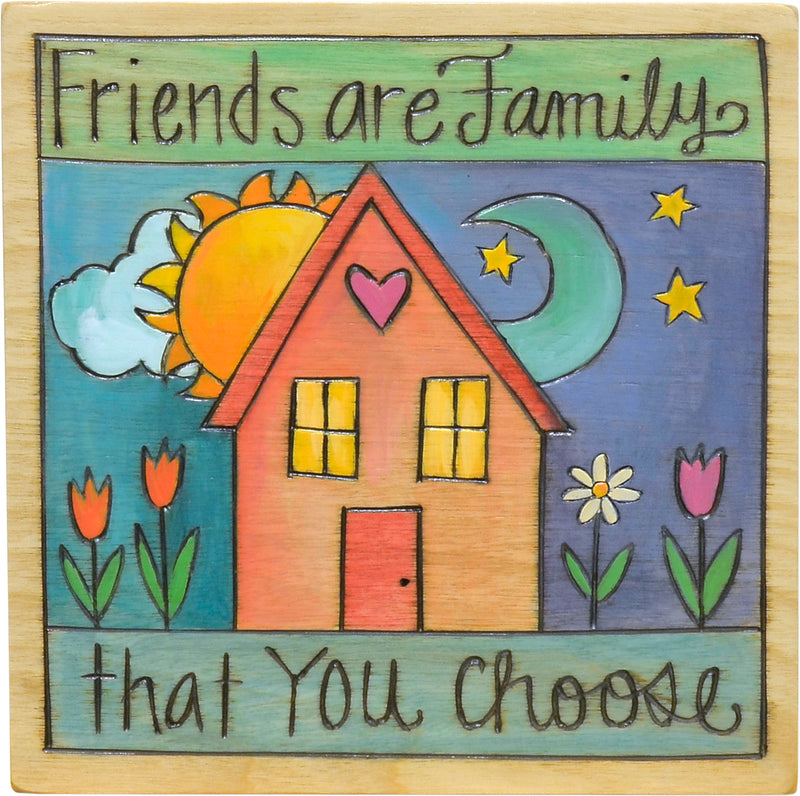 """Friends are family"" friendship themed plaque with a cozy home motif"