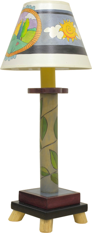 Log Candlestick Lamp –  Lovely lamp with a vine-wrapped base and day and night tree of life shade motif