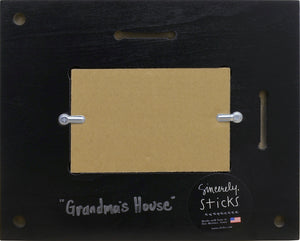 """Grandma's House"" Picture Frame – ""Life is an Adventure, Partake"" frame with home and sunset on the horizon motif back view"