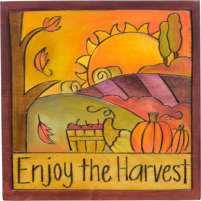 """Enjoy the harvest"" plaque with a fall bounty motif"