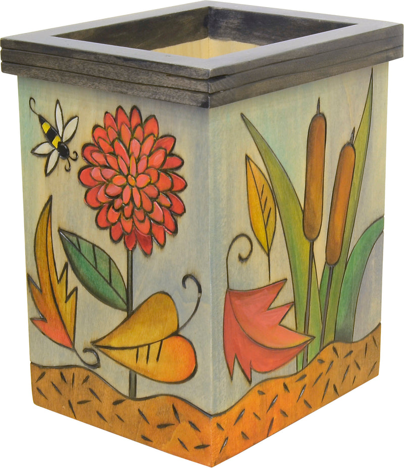 Fall foliage with leaves falling about motif box vase