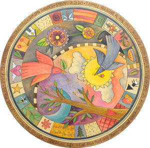 Birds fly by a tree of life encircled in boxed icons tabletop motif