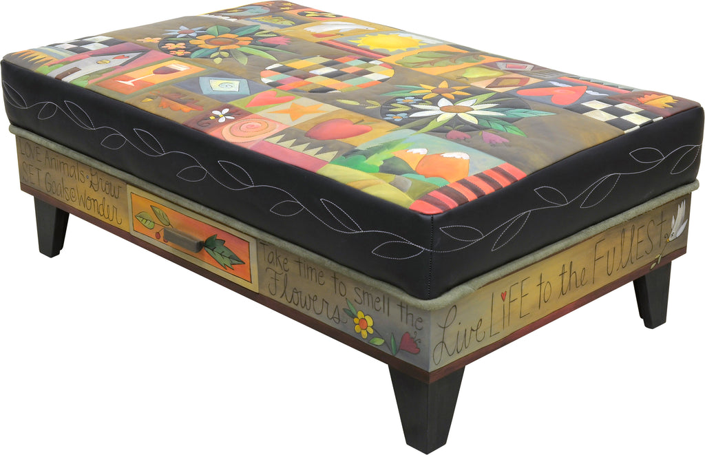 Crazy quilt ottoman motif with center floral sprays and a contrasting stitched vine around its edge