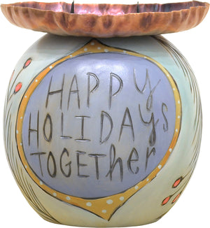 """Happy holidays together"" candle holder with a cozy winter home motif"