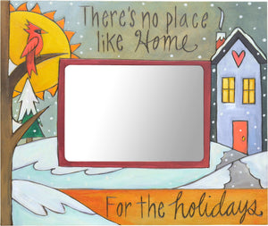 """There's no place like home for the holidays"" frame with a house under a fresh blanket of snow"