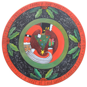 "20"" Lazy Susan – Whimsical Santa holding a present with holly and glitter accents in a traditional red and green palette"
