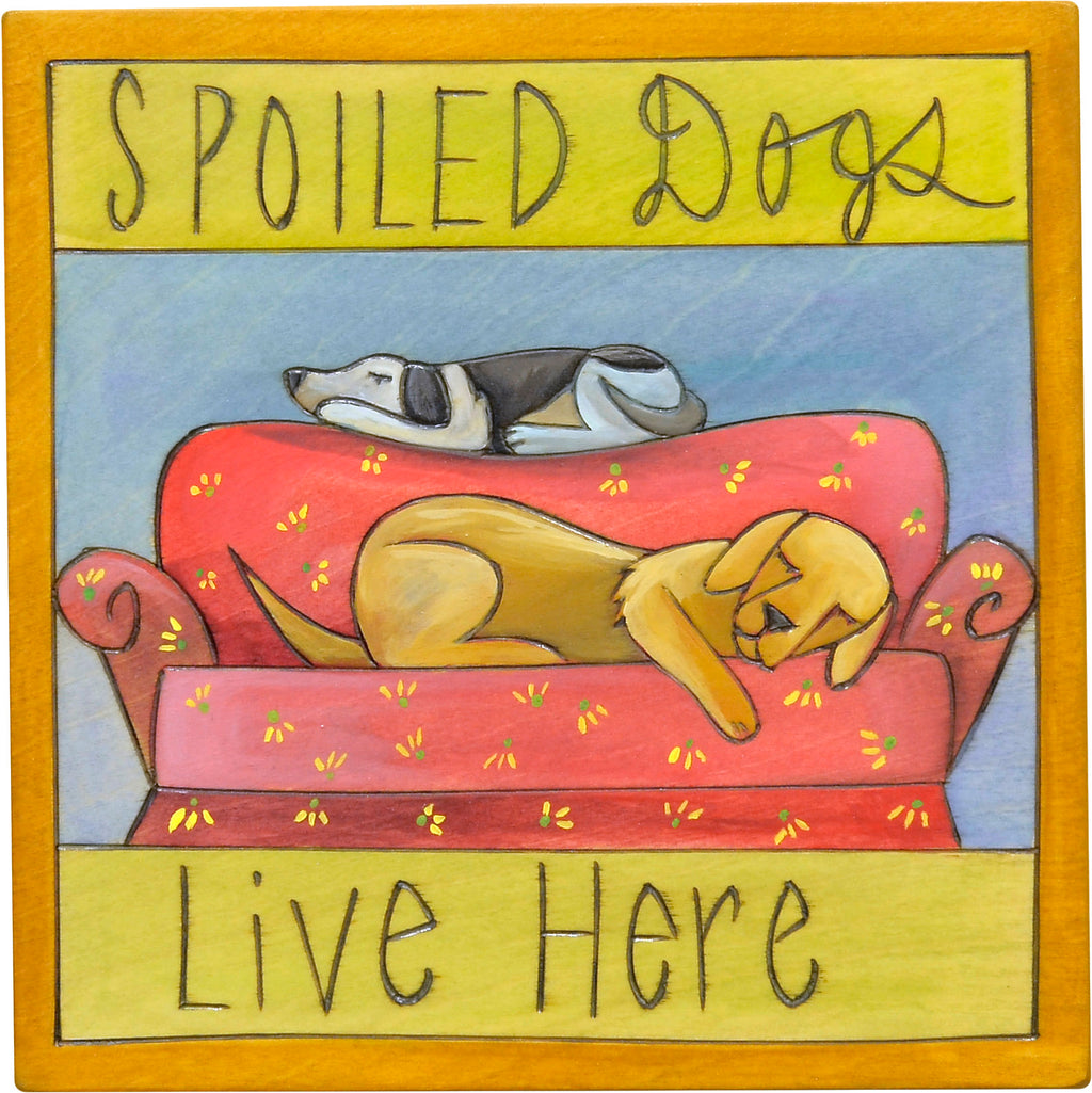 """Spoiled dogs live here"" plaque with two sleepy dogs on a couch design"