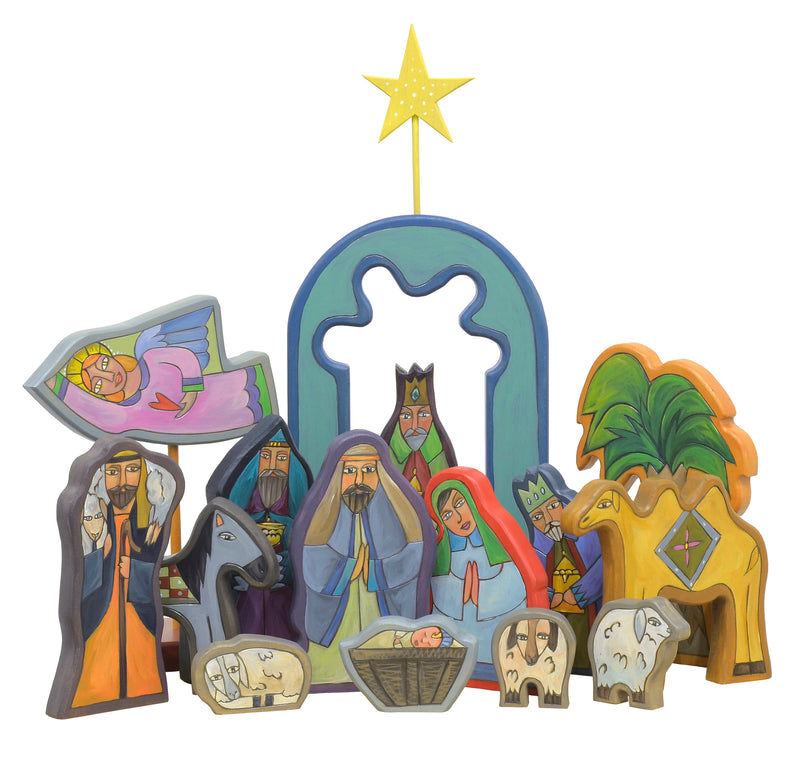 Nativity sculpture done in a vibrant palette predominately in blue tones
