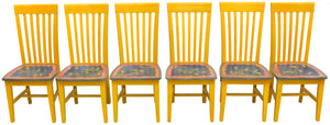 Understated, colorful chair set with vine motifs on the seats