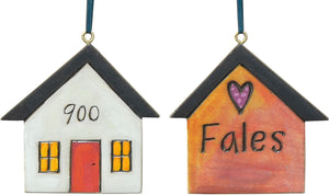 Remember your first pad and your forever home with this custom house ornament