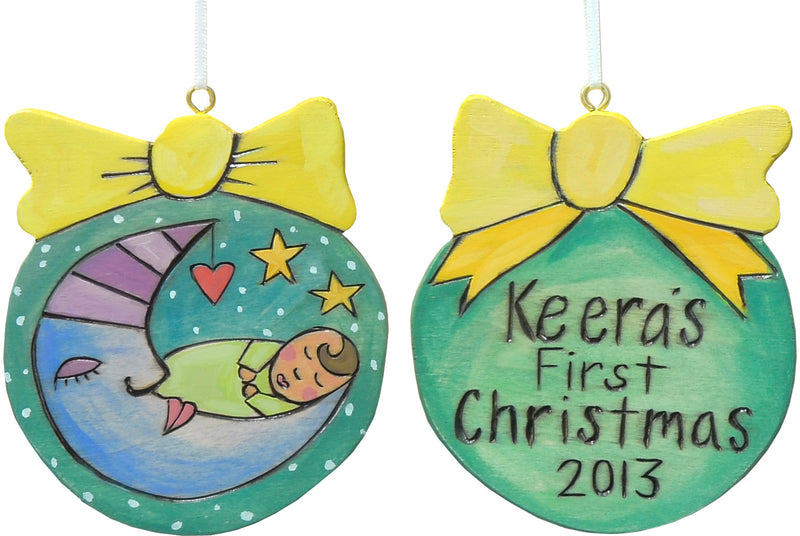 Remember a little one's first Christmas with this ball and bow ornament