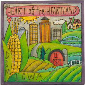 """The Heart of the Heartland"" Des Moines Iowa themed plaque nestled into a rural landscape"