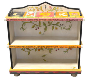 Fun crazy quilt bookcase design featuring polka-dots and floral vine accents