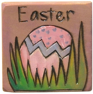 A sweet little Easter egg nestled in grass to mark Easter Sunday with this magnet