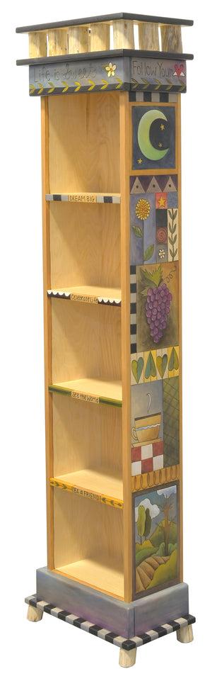 "Tall Skinny Bookcase –  ""Live is sweet"" bookcase with short, sweet phrases down fronts of shelves and crazy quilt designs down the sides main view"