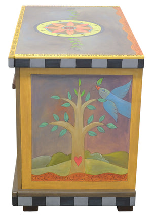 Small Dresser –  Eclectic dresser with boxed icon drawer fronts, tree of life scenes on sides, and flower medallion on top right view