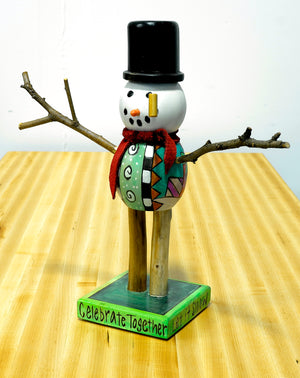 "Extra Small Snowman Sculpture –  Vibrant ""celebrate together"" snowman with polka-dot presents on his body front view"