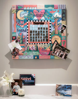 """This Sweet Life"" Perpetual Calendar – Cute ""follow your heart"" floating icon and crazy quilt mashup motif on a canvas calendar displayed in a home's kitchen"