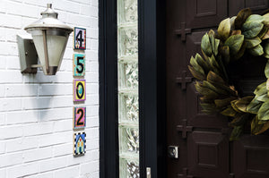 "Example of Sincerely, Sticks ""0"" house number plaque at a front door"