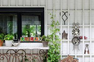 Example of Sincerely, Sticks alphabet letter plaques to say Relax on window sill