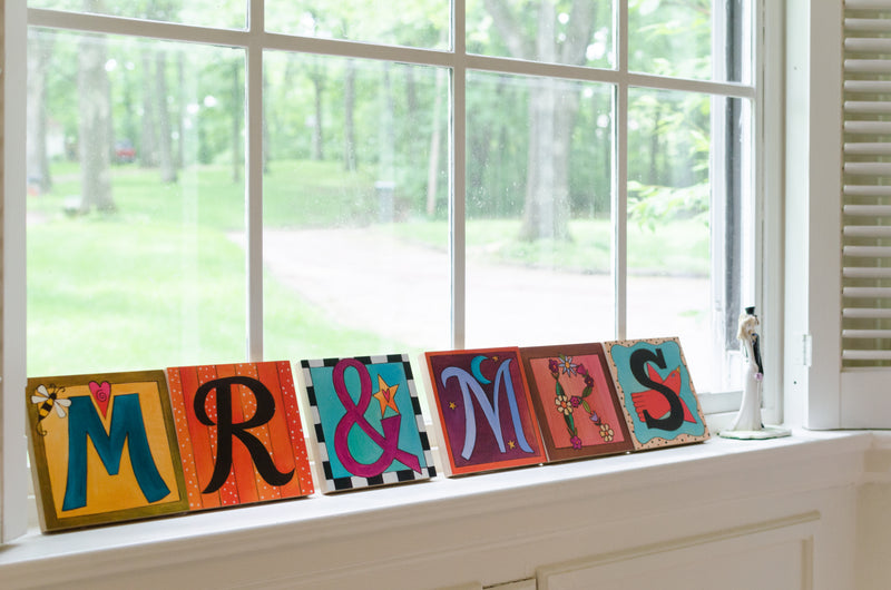 "Sincerely, Sticks printed letter plaques spelling out the phrase ""Mr & Mrs"""