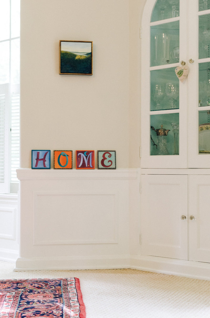 "Sincerely, Sticks printed letter plaques spelling out the word ""Home"""